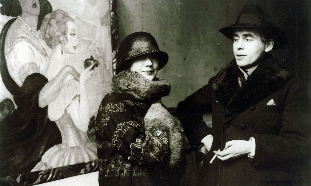 Gerda and Einar Wegener in front of Gerda's painting Sur la route d'Anacapri at an exhibition in 1924 @ The Royal Library, Denmark
